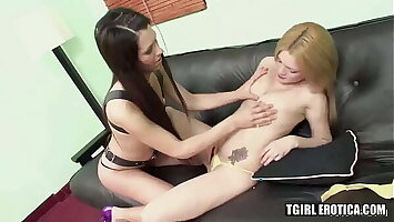 Hot shemales Tania and Kiara having hard anal fuck on a sofa