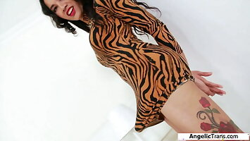 Busty ladyboy Cindy Dollar T jerks off her shecock and pees